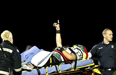 Josh Peckler - Jpeckler@shawmedia.com Crystal Lake South's Vinny Atella puts his hand in the air after being taken off the field on a stretcher by paramedics during the first quarter at Prairie Ridge High School Friday, September 28, 2012.