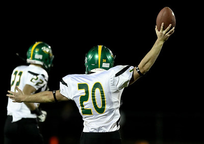 Josh Peckler - Jpeckler@shawmedia.com Crystal Lake South's Mitch Perik holds up the football after recovering a fumble during the first quarter at Prairie Ridge High School Friday, September 28, 2012.