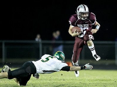 Josh Peckler - Jpeckler@shawmedia.com Prairie Ridge quarterback Brent Anderson (22) jumps to avoid a tackle by Crystal Lake South's Dennis Gardeck during the second quarter at Prairie Ridge High School Friday, September 28, 2012.