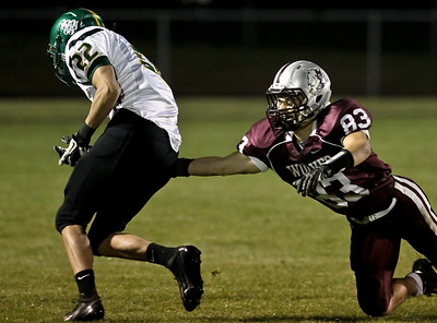 Josh Peckler - Jpeckler@shawmedia.com Prairie Ridge's Ross Carpenter (83) attempts to tackle Crystal Lake South's Corbin Pennino after he intercepted the ball during the second quarter at Prairie Ridge High School Friday, September 28, 2012.