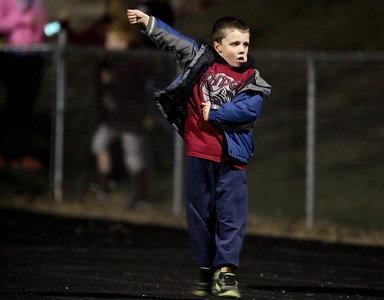 Josh Peckler - Jpeckler@shawmedia.com Andy Koeppen, 5 of Crystal Lake dances to the music prior to the start of a football game between Prairie Ridge and Crystal Lake South at Prairie Ridge High School Friday, September 28, 2012.