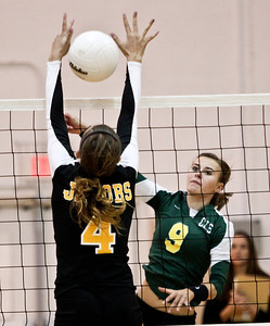 Josh Peckler - Jpeckler@shawmedia.com Crystal Lake South's Nicole Jurkash (9) attempts to hit the ball past Jacobs' Alyssia Dugo during the second set at Jacobs High School Thursday, September 20, 2012. Crystal Lake South won the match in two sets.