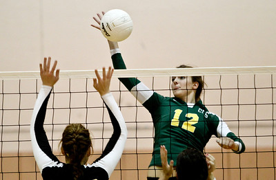 Josh Peckler - Jpeckler@shawmedia.com Crystal Lake South's Nicole Slimko goes up to hit the ball over the Jacobs block during the second set at Jacobs High School Thursday, September 20, 2012. Crystal Lake South won the match in two sets.