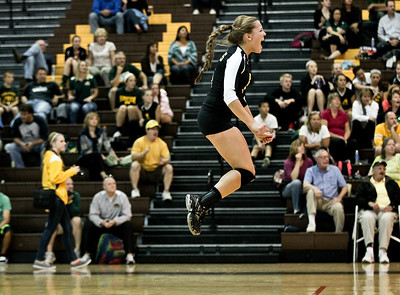 Josh Peckler - Jpeckler@shawmedia.com Jacobs' Maris Smith jumps in the air while celebrating a point against Crystal Lake South during the second set at Jacobs High School Thursday, September 20, 2012. Crystal Lake South won the match in two sets.