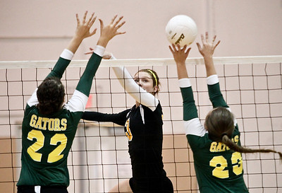 Josh Peckler - Jpeckler@shawmedia.com Jacobs' Alyssa Ehrhardt (3) attempts to tip the ball over Crystal Lake blockers Kylie Portera (22) and Lindsey Murphy during the first set at Jacobs High School Thursday, September 20, 2012. Crystal Lake South won the match in two sets.