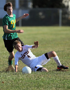 Sarah Nader - snader@shawmedia.com Crystal Lake Central's Jake Sigmund (right) steals the ball from Crystal Lake South's Jack Carlson during the first half of Thursday's game in Crystal Lake on September 6, 2012. Crystal Lake South won, 3-2.