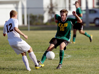 Sarah Nader - snader@shawmedia.com Crystal Lake South's Michael Conley (right) is guarded by Crystal Lake Central's Jordan Fisher while he brings the ball down field during the first  half of Thursday's game in Crystal Lake on September 6, 2012. Crystal Lake South won, 3-2.