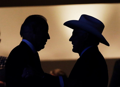 Vice President Joe Biden speaks Secretary of the Interior Ken Salazar during the Democratic National Convention in Charlotte, N.C., on Tuesday, Sept. 4, 2012. (AP Photo/Charlie Neibergall)