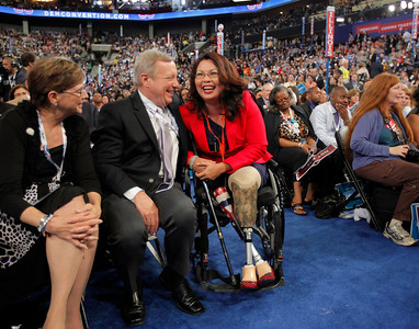 U.S. Sen. Dick Durbin talks to Former Assistant Secretary, U.S. Department of Veterans Affairs Tammy Duckworth during the Democratic National Convention in Charlotte, N.C., on Tuesday, Sept. 4, 2012. (AP Photo/Charles Dharapak)