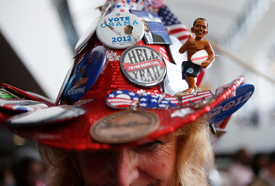 Kelly Jacobs, from Hernando, Miss., wears button laden campaign hat while touring the convention hall ahead of the Democratic National Convention in Charlotte, N.C., on Monday, Sept. 3, 2012. (AP Photo/Jae C. Hong)