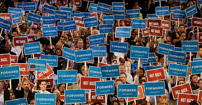 Delegates hold up signs during Maryland Gov. Martin O'Malley speech at the Democratic National Convention in Charlotte, N.C., on Tuesday, Sept. 4, 2012. (AP Photo/Charlie Neibergall)