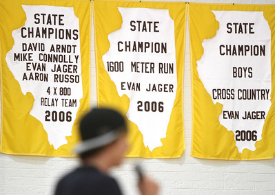 Mike Greene - mgreene@shawmedia.com Olympian Evan Jager speaks surrounded by State Championship banners during a homecoming ceremony for Jager Wednesday, September 5, 2012 at Jacobs High School in Algonquin. Jager, a 2007 graduate of Jacobs, took sixth place in the 3000-meter steeplechase at the 2012 London Olympics.