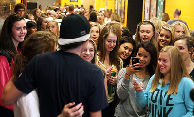 Mike Greene - mgreene@shawmedia.com A line of students and community members wait to get their photos taken with Olympian Evan Jager following a homecoming ceremony for Jager Wednesday, September 5, 2012 at Jacobs High School in Algonquin. Jager, a 2007 graduate of Jacobs, took sixth place in the 3000-meter steeplechase at the 2012 London Olympics.