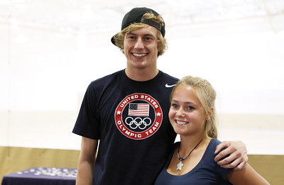 Mike Greene - mgreene@shawmedia.com Olympian Evan Jager poses for a photo with Payton Spirling, 16 of Algonquin, before the start of a homecoming ceremony for Jager Wednesday, September 5, 2012 at Jacobs High School in Algonquin. Jager, a 2007 graduate of Jacobs, took sixth place in the 3000-meter steeplechase at the 2012 London Olympics.
