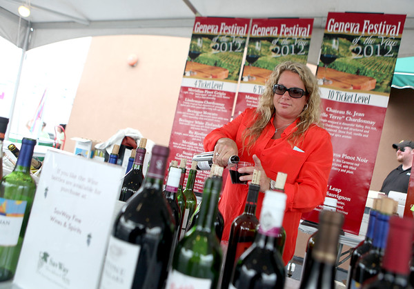 Lisa DiVencenzo of Southern Wine and Spirits in Bolingbrook pours wine for a customer during the first day of the Geneva Festival of the Vine Friday.