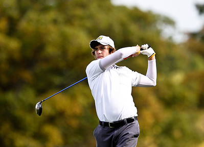 Josh Peckler - Jpeckler@shawmedia.com Prairie Ridge's Pat Biewald tees off on the 13th hole during the Fox Valley Conference Boys Golf Meet at Crystal Woods Golf Club in Woodstock Thursday, September 27, 2012.