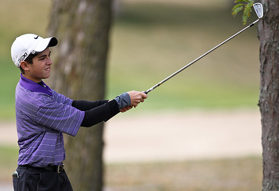 Josh Peckler - Jpeckler@shawmedia.com Hampshire's Geoff Beck watches his shot on the 12th hole during the Fox Valley Conference Boys Golf Meet at Crystal Woods Golf Club in Woodstock Thursday, September 27, 2012.