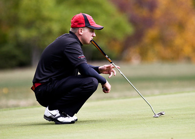 Josh Peckler - Jpeckler@shawmedia.com Huntley's AJ Fanselow focuses on his put on the 13th green during the Fox Valley Conference Boys Golf Meet at Crystal Woods Golf Club in Woodstock Thursday, September 27, 2012.