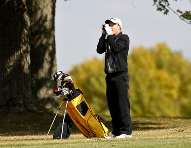 Josh Peckler - Jpeckler@shawmedia.com Jacob's Jack Ramsett uses a range finder to check his distance from the 13th hole during the Fox Valley Conference Boys Golf Meet at Crystal Woods Golf Club in Woodstock Thursday, September 27, 2012.