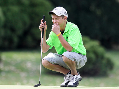 Josh Peckler - Jpeckler@shawmedia.com Crystal Lake South's Brandon Dahl checks the green of the 12th hole during the Fox Valley Conference Boys Golf Meet at Crystal Woods Golf Club in Woodstock Thursday, September 27, 2012.