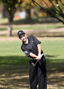 Josh Peckler - Jpeckler@shawmedia.com Woodstock's P.J. Senn chips up a ball onto the 12th green during the Fox Valley Conference Boys Golf Meet at Crystal Woods Golf Club in Woodstock Thursday, September 27, 2012.