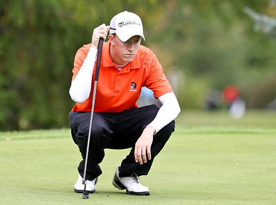 Josh Peckler - Jpeckler@shawmedia.com Mchenry's Riley Lindholm checks the green of the 16th green during the Fox Valley Conference Boys Golf Meet at Crystal Woods Golf Club in Woodstock Thursday, September 27, 2012.