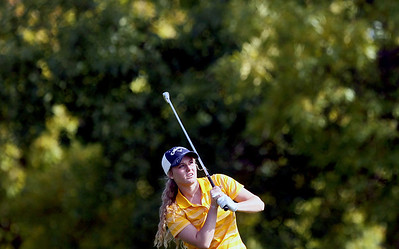 Sarah Nader - snader@shawmedia.com Jacobs' Kaitlyn Woloszyk watches her ball after teeing off while competing in the Fox Valley Conference girls golf meet at Crystal Woods Golf Club in Woodstock on Tuesday, September 25, 2012.
