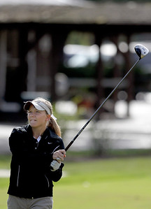 Sarah Nader - snader@shawmedia.com McHenry's Kaylee Ross watches her ball after teeing off while competing in the Fox Valley Conference girls golf meet at Crystal Woods Golf Club in Woodstock on Tuesday, September 25, 2012.
