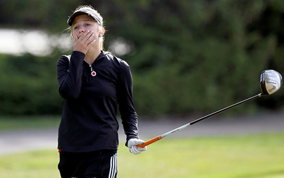 Sarah Nader - snader@shawmedia.com Huntley's Gillian Young reacts after teeing off while competing in the Fox Valley Conference girls golf meet at Crystal Woods Golf Club in Woodstock on Tuesday, September 25, 2012.
