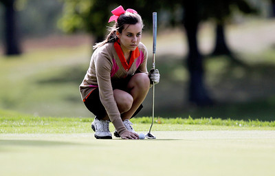 Sarah Nader - snader@shawmedia.com Crystal Lake Central's Lauren Kalamaras lines up her putt  while competing in the Fox Valley Conference girls golf meet at Crystal Woods Golf Club in Woodstock on Tuesday, September 25, 2012.