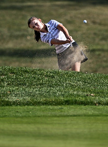 Sarah Nader - snader@shawmedia.com Prairie Ridge's Michelle Nalepa hits out of a bunker while competing in the Fox Valley Conference girls golf meet at Crystal Woods Golf Club in Woodstock on Tuesday, September 25, 2012.