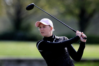 Sarah Nader - snader@shawmedia.com McHenry's Delaney Buenzli watches her ball after teeing off while competing in the Fox Valley Conference girls golf meet at Crystal Woods Golf Club in Woodstock on Tuesday, September 25, 2012.