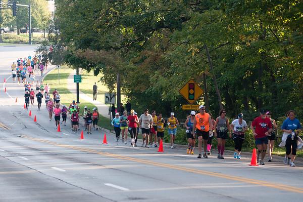 Runners of the Fox Valley Marathon run down Route 31 in Geneva Sunday morning.