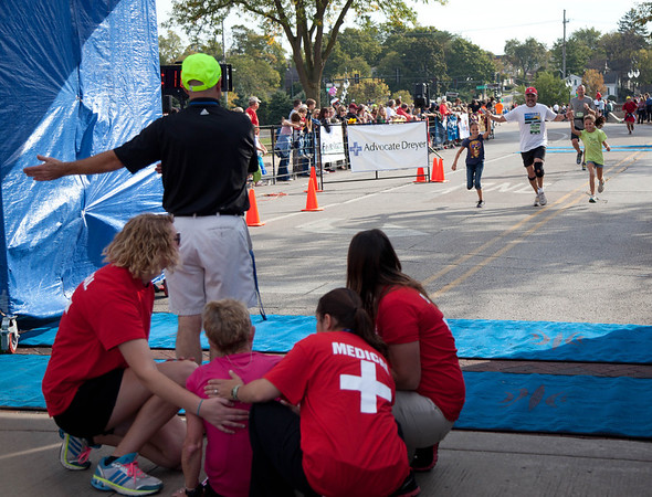 Medical attention is needed at the finish line during the Fox Valley Marathon in St. Charles Sunday morning.
