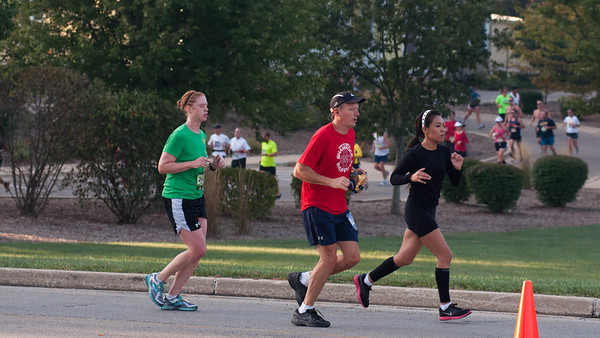 Runners of the Fox Valley Marathon make their way through Geneva Sunday morning.