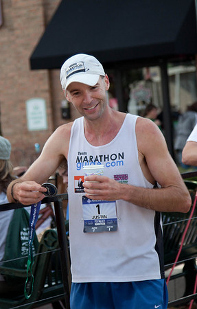 The male winner of the Fox Valley Marathon Justin Gillette, from Indiana, cools off after the race in St. Charles Sunday morning.