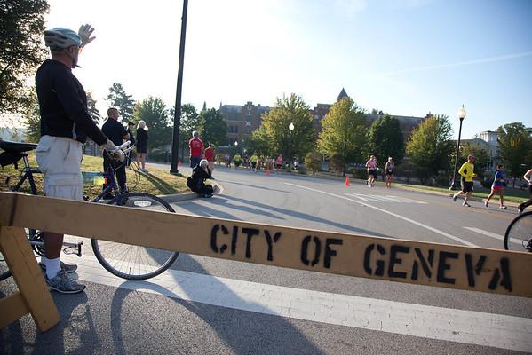 Bistanders wave to the Fox Valley Marathon runners in Geneva Sunday morning.