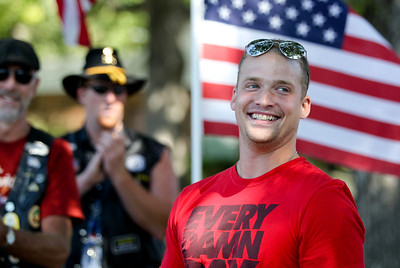 Mike Greene - mgreene@shawmedia.com Army Specialist Dustin Largen smiles while surveying the crowd gathered for his welcome home celebration Saturday, September 15, 2012 at Veterans of Foreign War Post 4600 in McHenry. Largen served in the Army's 82nd Airborne Division, serving in both Iraq and Afghanistan during his four-year enlistment.