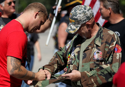 Mike Greene - mgreene@shawmedia.com Army Specialist Dustin Largen signs Marine Veteran Ken Keller's jacket during a welcome home celebration Saturday, September 15, 2012 at Veterans of Foreign War Post 4600 in McHenry. Largen served in the Army's 82nd Airborne Division, serving in both Iraq and Afghanistan during his four-year enlistment.