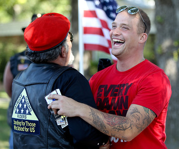 Mike Greene - mgreene@shawmedia.com Army Specialist Dustin Largen laughs while receiving a hug from Army Veteran and Patriot Guard Rider Chuck Serpe during a welcome home celebration Saturday, September 15, 2012 at Veterans of Foreign War Post 4600 in McHenry. Largen served in the Army's 82nd Airborne Division, serving in both Iraq and Afghanistan during his four-year enlistment.