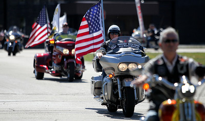 Mike Greene - mgreene@shawmedia.com Members of the Warriors' Watch Riders and the Patriot Guard Rider pull into Veterans of Foreign War Post 4600 during a welcome home celebration for Army Specialist Dustin Largen Saturday, September 15, 2012 in McHenry. Largen served in the Army's 82nd Airborne Division, serving in both Iraq and Afghanistan during his four-year enlistment.