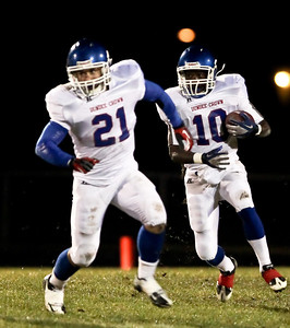 Josh Peckler - Jpeckler@shawmedia.com Dundee Crown's JT Beasley (10) runs the ball with Cody Lane (21) lead blocks during the second quarter at Huntley High School Friday, September 21, 2012.