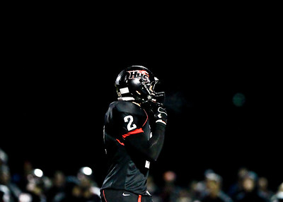 Josh Peckler - Jpeckler@shawmedia.com Huntley's Mike Andrews has steam come out of his face mask as temperatures dropped to the low 50s during the first quarter against Dundee Crown at Huntley High School Friday, September 21, 2012.