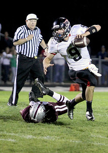 Sarah Nader - snader@shawmedia.com Prairie Ridge's Kevin Grant falls to the ground while trying to sack Huntley's quarterback Kam Sallee during the second quarter of Friday's in Crystal Lake on August 7, 2012.