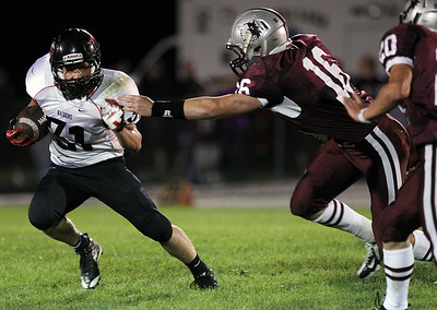 Sarah Nader - snader@shawmedia.com Huntley's Jake Scalise (left) runs past Prairie Ridge's Sean Folliard during the second quarter of Friday's in Crystal Lake on August 7, 2012.