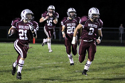 Sarah Nader - snader@shawmedia.com Prairie Ridge's Matt Perhats (left) brings the ball down field during Friday's game in Crystal Lake on August 7, 2012.