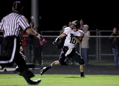 Sarah Nader - snader@shawmedia.com Huntley's Bryce Beschorner eyes the ball before making the touchdown pass during the first quarter of Friday's game against Prairie Ridge in Crystal Lake on August 7, 2012.
