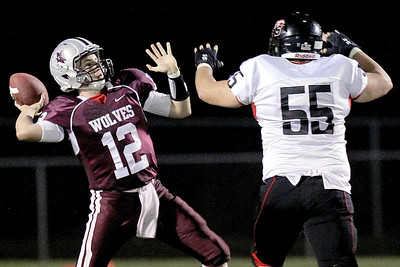 Sarah Nader - snader@shawmedia.com Huntley's Jeff Chan (right) tries to block a pass by Prairie Ridge's quarterback Oliver Kremer during the second quarter Friday's game in Crystal Lake on August 7, 2012.