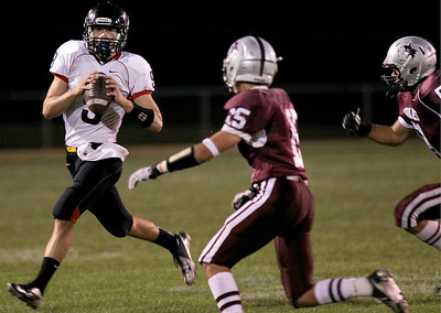 Sarah Nader - snader@shawmedia.com Huntley's quarterback Kam Sallee throws a pass during the first quarter of Friday's game against Prairie Ridge in Crystal Lake on August 7, 2012.