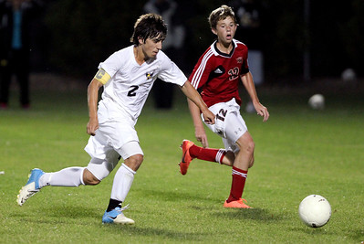 Mike Greene - mgreene@shawmedia.com Jacobs' Anthony Moscatello (left) drives towards the goal while being defended by Huntley's Jason Zobott during a match Tuesday, September 25, 2012 at Jacobs High School in Algonquin. Moscatello scored a goal in Jacobs' 3-2 loss to Huntley.